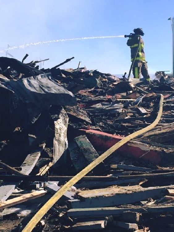 Rose Country Inn debris-firefighter - newsflash